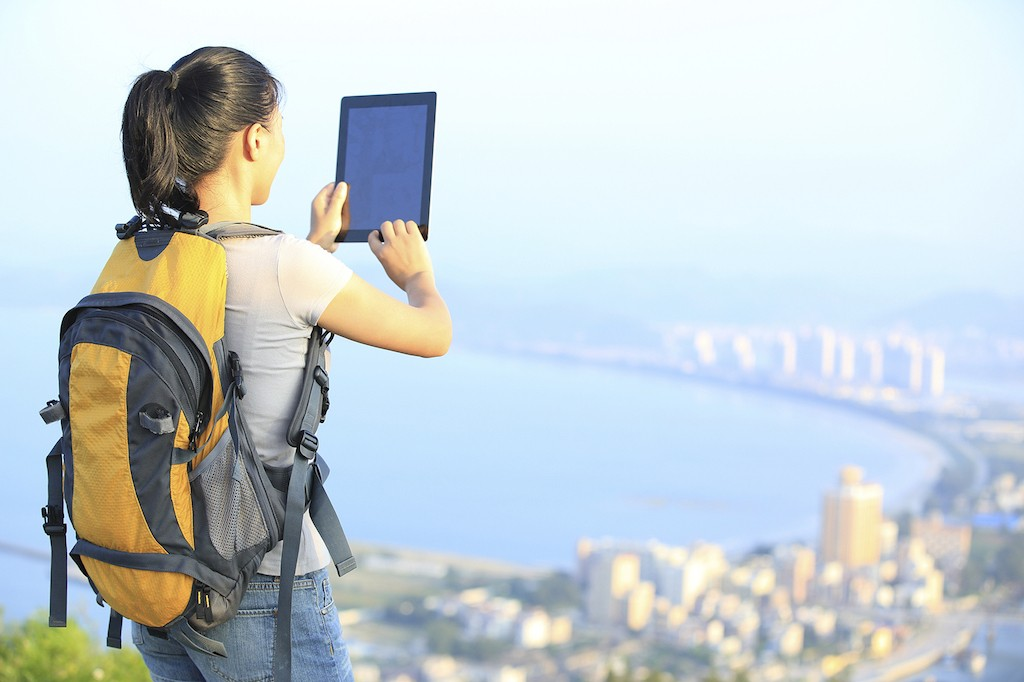 young woman hiker use digital tablet outdoor